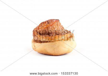 Cinnamon bun isolated on white background. Home baking