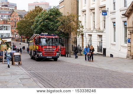 NOTTINGHAM ENGLAND - OCTOBER 22: Red British fire engine/truck proceeding up Low Pavement. In Nottingham England. On 22nd October 2016.