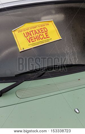 NOTTINGHAM ENGLAND - OCTOBER 22: A Nissan Figaro car with 'Untaxed Vehicle' sticker attached to windshield. In Nottingham England. On 22nd October 2016.