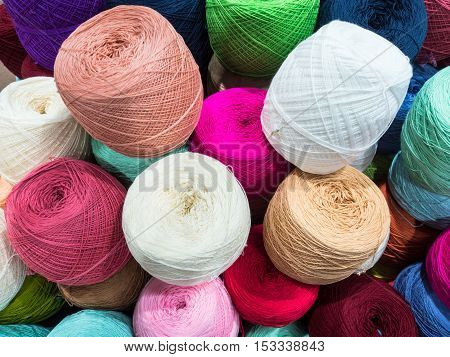 Multi color balls of wool and knitting.
