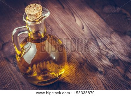 View Top Of Olive Oil Container Bottle With Stopper On Wood Table Background,  Vintage Style
