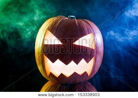 Glowing Pumpkins And Smoke For Halloween On Black Background