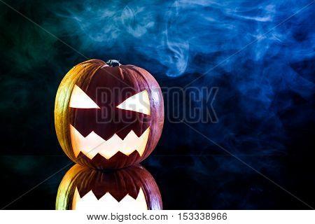 Smoking Pumpkin With Candle And Smoke For Halloween