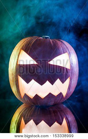Smoking Scary Halloween Pumpkin Head On Black Background