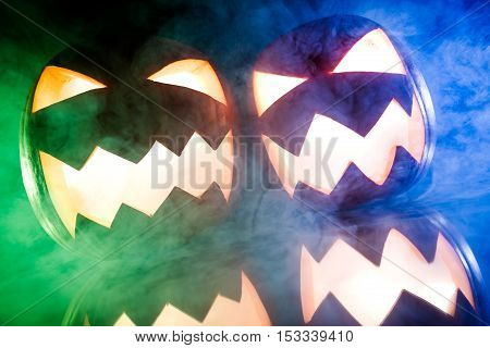 Glowing Pumpkins With Blue And Green Smoke For Halloween