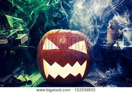 Closeup of scary pumpkin for Halloween on old wooden table