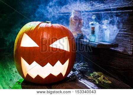 Glowing Halloween Pumpkin With Blue And Green Light