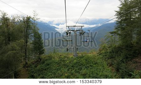 People ride on the cableway in the mountains