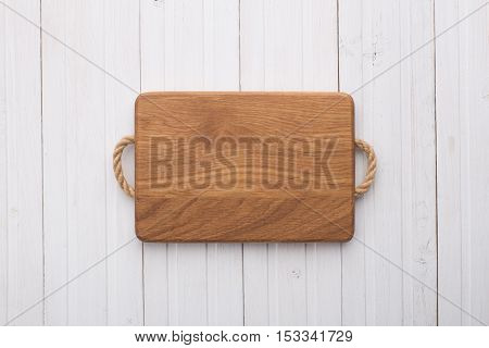 Cutting board on a white wooden table