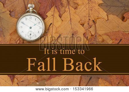 Daylight Savings Time message Some fall leaves and retro pocket watch with text It is time to fall back