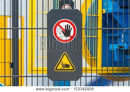 Warning sign for safety on machine no entry and be careful of hand