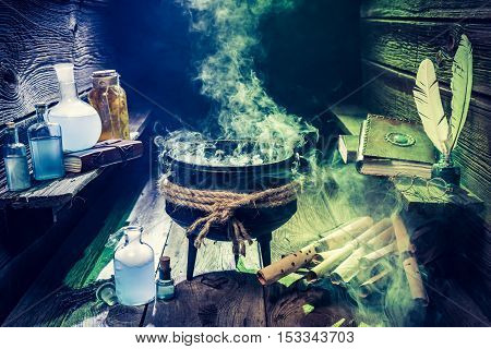 Magical Witcher Cauldron With Blue Potions And Green Scrolls For Halloween
