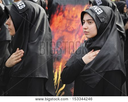 Istanbul Turkey - October 11 2016: Turkish Shia girls takes part in an Ashura parade in Istanbul's district of Kucukcekmece. Turkish Shia Muslims mourning for Imam Hussain. Caferis take part in a mourning procession marking the day of Ashura in Istanbul's