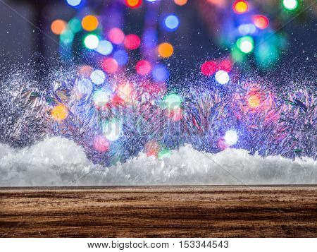 Frozen window with blurred colored lights on the background.