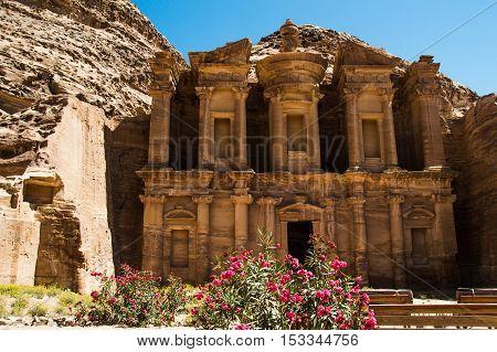 Photo of the Exterior view monastery Ad Deir with oleander bush Petra Jordan
