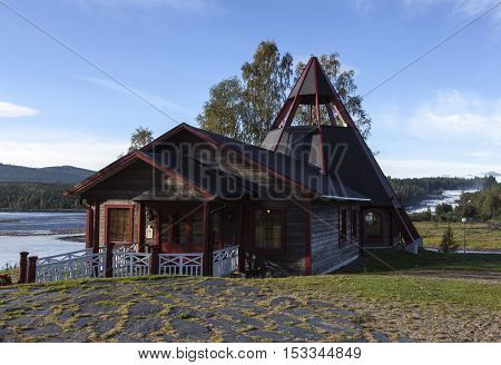 STORFORSEN, SWEDEN ON AUGUST 21. View of a wooden Chapel on a hill this side a rapid in a river on August 21, 2016 in Storforsen, Sweden. The Chapel and it´s vicinity. Editorial use.