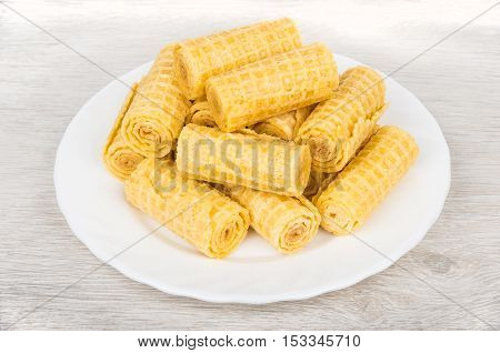 Heap Of Wafer Rolls In White Glass Plate On Table