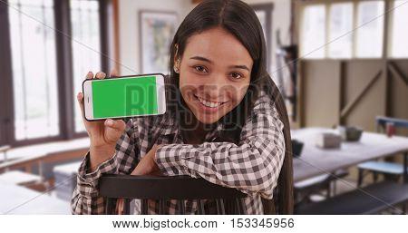 Mexican Woman Student Holding Smartphone With Green Screen