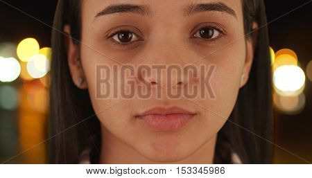 Close up of Latina woman looking at camera