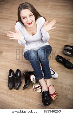 young Woman trying on shoes and scream