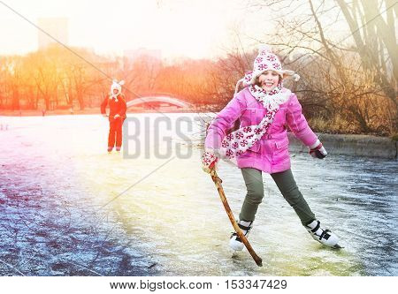 beautiful happy preteen girl figure skating in open winter skating rink