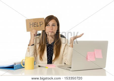 young attractive sad and desperate businesswoman suffering stress at office laptop computer desk holding help sign looking depressed and overwhelmed in business crisis and problem concept