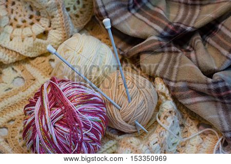 three colorful threads for knitting with spokes