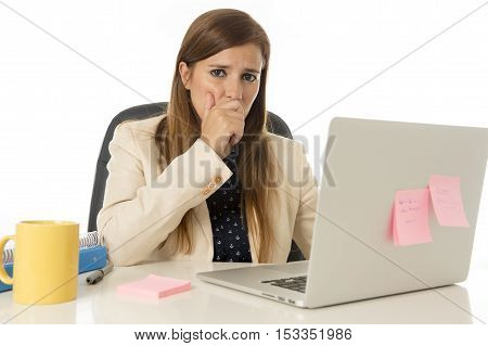 young attractive sad and desperate businesswoman suffering stress at office laptop computer desk looking worried depressed and overwhelmed in business crisis and problem concept