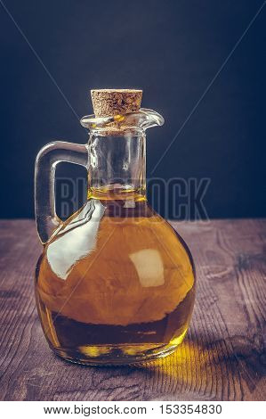 Olive Oil Container Bottle With Stopper On Wood Table Background,  Vintage Style
