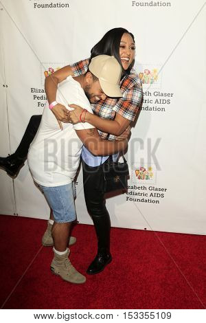 LOS ANGELES - OCT 23:  Tahj Mowry, Tia Mowry at the Elizabeth Glaser Pediatric AIDS Foundation A Time For Heroes Event at Smashbox Studios on October 23, 2016 in Culver City, CA