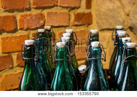 Empty green and brown vintage bottles in a box