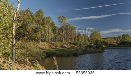 Pond in mountain Krusne hory in autumn time