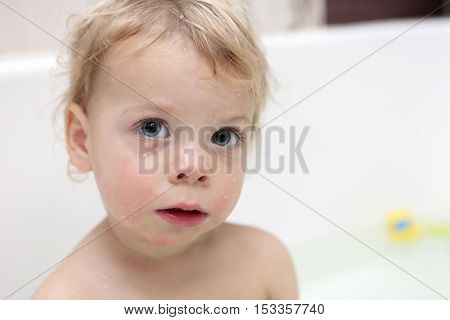 Pensive Child At Bathroom