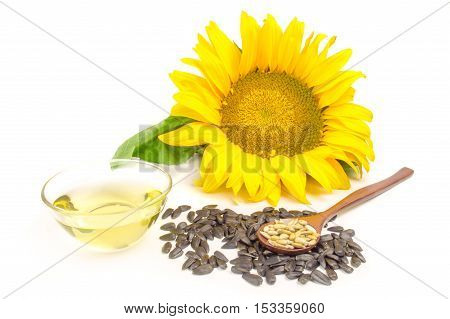 sunflower with oil and seeds on a white background.