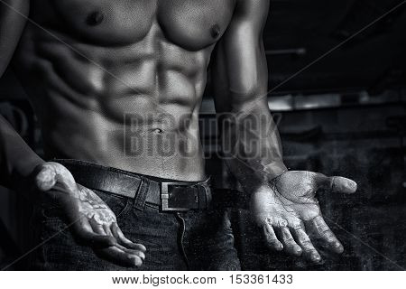 Sport. Unrecognizable young athlete is going to do exercise with weight -- toned and stylized photo