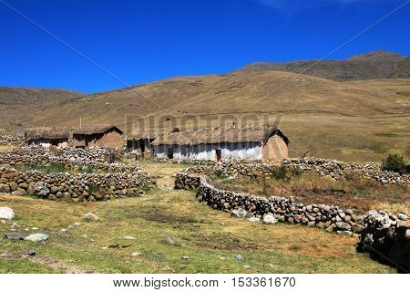 Typical adobe house in the andean mountains of Peru near Cusco