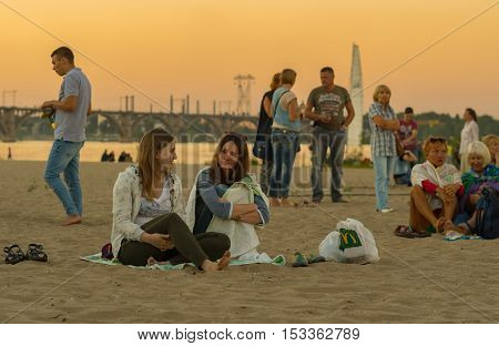 DNEPR UKRAINE - SEPTEMBER 10 2016:People sitting on a Dnepr river beach before