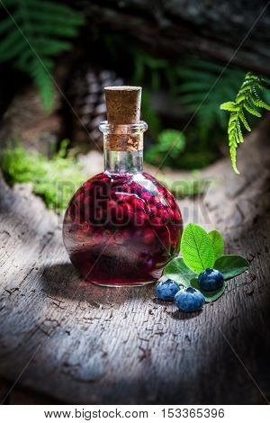 Sweet Liqueur In A Bottle With Alcohol And Blueberries