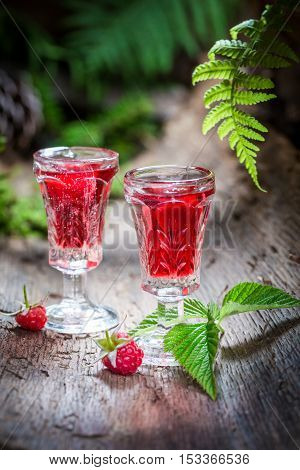 Fresh Raspberries Liqueur Made Of Alcohol And Fruits