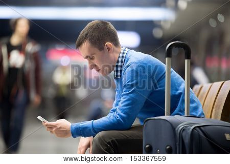 Young Traveler Waiting At Airport