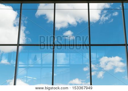 Window pane with clouds and blue sky