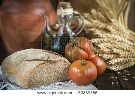 Olive Oil With Jam Bread And Tomatoes