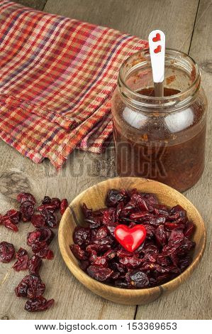 Dried cranberries in a bowl. Healthy superfood. Dried cranberries on the kitchen table. Diet food.