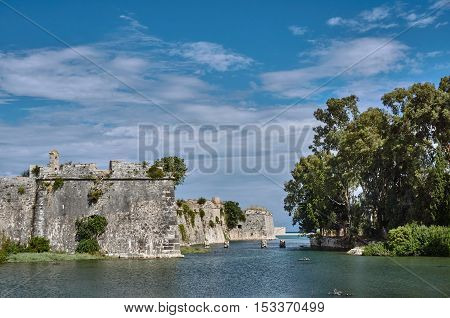 Moat and walls of the Venetian fortress of Agia Maura at the Greek island of Lefkada