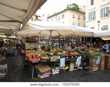 ROME ITALY - JUNE 15 2015: Fresh fruits and vegetables for sale in Campo de Fiori famous outdoor market in central Rome.