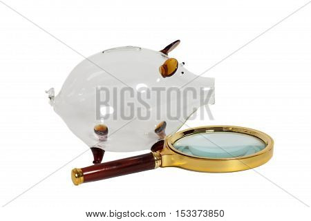 Glass Piggy bank with magnifying glass isolated on white