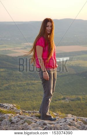 Woman standing on the hilltop