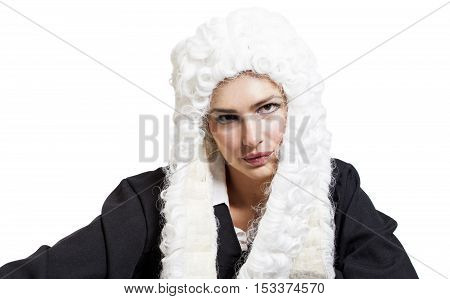 Female judge wearing a wig and black mantle isolated on white