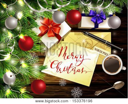 Christmas New Year design light wooden background with christmas tree and silver and red balls and wish list coffee teaspoon gift boxes envelope for santa and pen and handwritten Merry Christmas.
