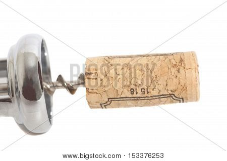 cork on corkscrew isolated on white background
